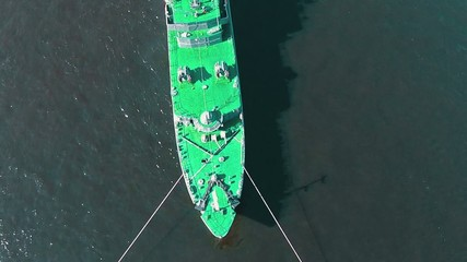 Aerial View Warship Moored on Buoys, sunny day