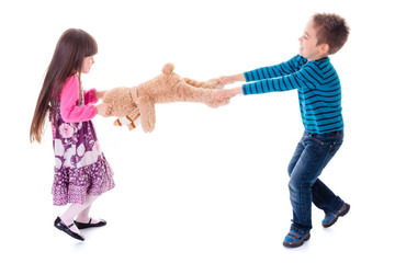 Boy and girl pulling toy bear