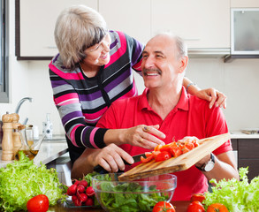 happy loving elderly couple in kitchen