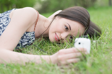 Young asian woman using smart phone outdoor