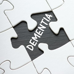The word DEMENTIA under a missing jigsaw puzzle piece