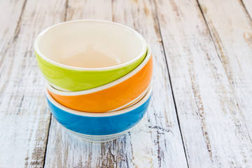 colorful ceramic bowl on the wooden background