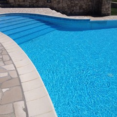 swimming pool in a sunny day