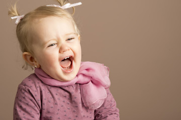 Baby girl laughing uproariously