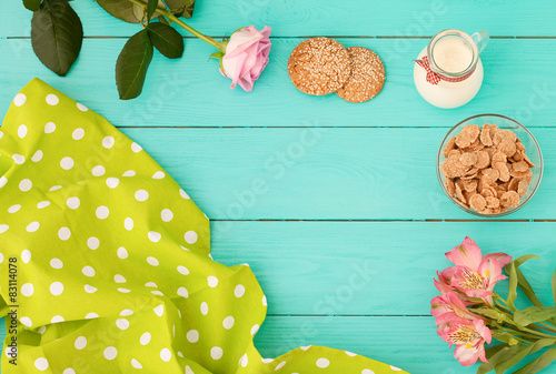 Plakat breakfast on blue wooden background,tablecloth ,flowers.
