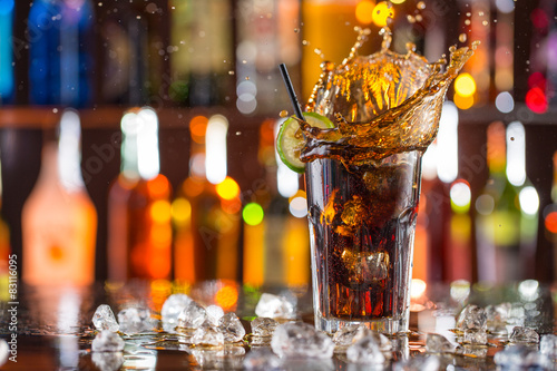 Glass of cola on bar desk Poster