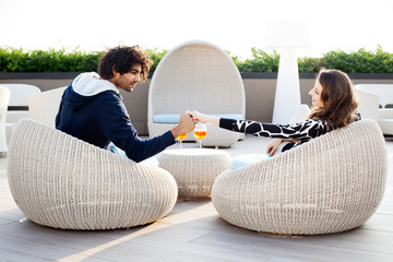 couple holding hands while drinking an aperitif