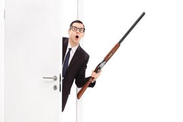 Angry businessman holding a shotgun rifle