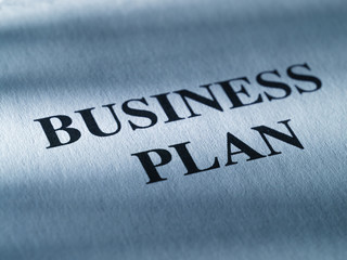 """The inscription """"business plan"""" on a sheet of paper."""