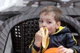 Boy eating banana