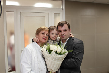 Family with bunch of flowers
