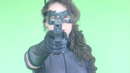 young girl shooting with gun green screen