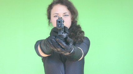 young girl shooting with gun green screen