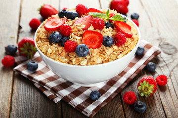 Oatmeal with berries on brown wooden background