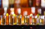 Fototapety Variation of hard alcoholic shots on bar counter
