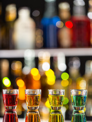 Variation of hard alcoholic shots on bar counter