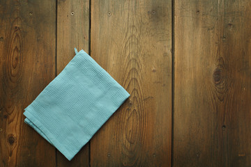 An old wooden kitchen table with kitchen dish cloth