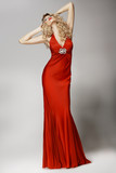 Seductive Shapely Woman in Red Dress posing