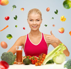 happy woman with vegetarian food showing thumbs up