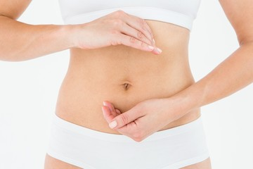 Fit woman with hands on her stomach