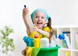 Cute little girl cleanses a floor