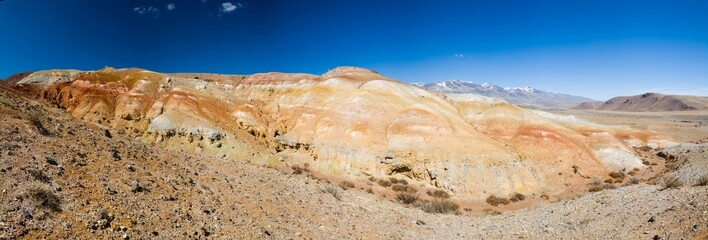 Panorama of red mountains against the blue sky. Altai