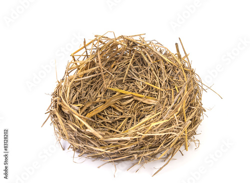 Empty straw nest with twigs on a white background