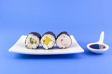 sushi three pieces with soy sauce