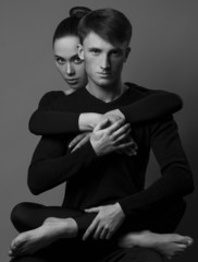 black and white fashion photo of sexy impassioned couple posing