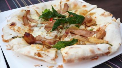 Close up of thin crispy fusion pizza