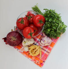 Vegetables for coocking pasta: garlic, onion, tomato, parley