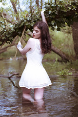 Woman Wearing White Sun Dress Standing in Water