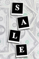 word sale on the dollars background