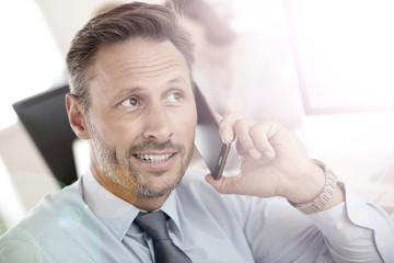 Portrait of businessman talking on mobile phone