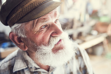 Close up of a senior craftsman in his workshop