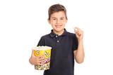 Joyful kid holding a big box of popcorn
