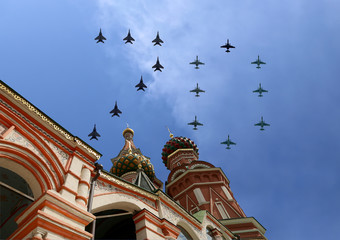 Russian military aircrafts fly in formation over Moscow