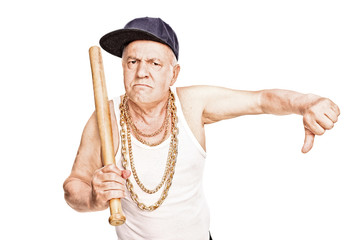 Violent senior with baseball bat giving a thumb down