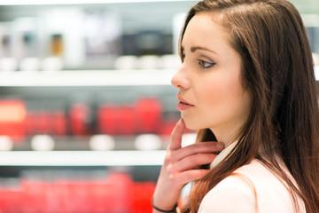 Woman shopping in a beauty shop