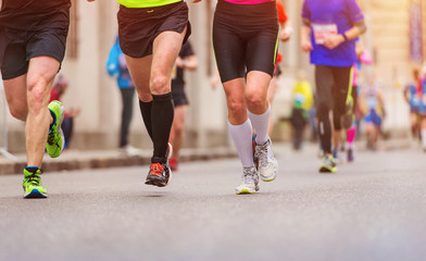Unrecognizable young runners in the city race