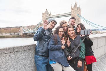 Group of friends enjoying taking a selfie in London