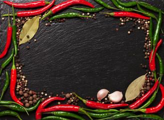 Chili pepper, peppercorn, garlic and bay leaves