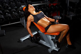 Brunette fitness woman in a gym