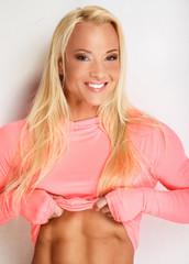 Blond female in pink sportswear