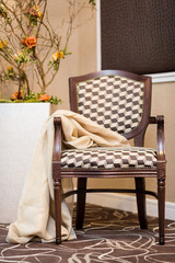 Upholstered stylish wooden chair in brown/beige