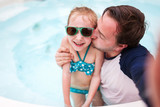 Father and daughter at swimming pool