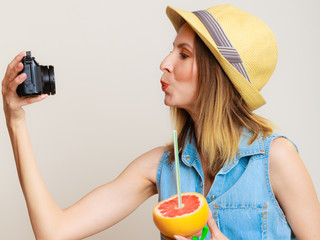 Summer girl taking self picture selfie with camera