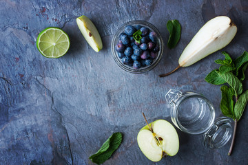 Ingredients for smoothie from apple, pear and blueberry