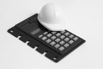 Сувенир строительная каска и калькулятор