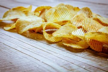 Heap of Paprika Potato Chips on rustic background